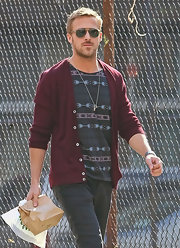 Ryan Gosling looked like a rugged hipster in a maroon cardigan.
