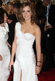 Emma Watson complemented her one-shoulder dress with a duo of Burberry Prorsum bangle bracelets for the Met Gala.