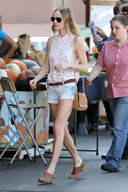 Kate Bosworth accessorized her outfit with a beaded suede shoulder bag by Mulberry.