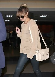 The aways on-trend Lauren Conrad travels in style. To wit: Here we see the reality star and author sporting a Cambridge Satchel through LAX.