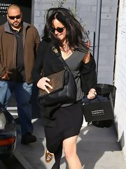 Jennifer Lawrence was spotted outside a salon carrying an edgy-stylish black leather bag with a metal-embellished flap.