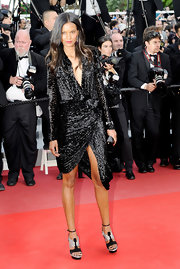 Liya Kebede's black and silver T-strap platform sandals added a futuristic touch to her look.