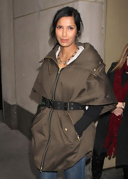 Padma Lakshmi accessorized with an oversized, grommeted belt for some shape to her bulky coat.