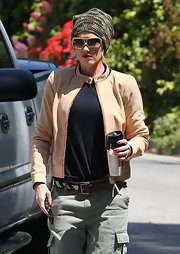 Gwen Stefani got some sun protection in chic style with a pair of designer shield sunglasses.