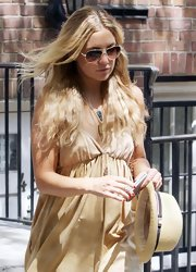 Kate Hudson kept a straw hat handy while out and about in New York City.