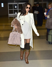 Eva Longoria stayed warm in style with this white Rachel Zoe wool coat during a flight to New York.