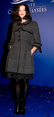 Marion Cotillard teamed her cute coat with a pair of black ankle boots by Christian Louboutin.