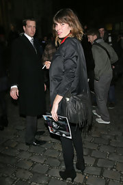 Lou Doillon accessorized with a fringed black shoulder bag when she attended the Givenchy fashion show.