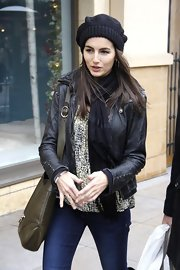 Camilla Belle teamed a black Love Quotes scarf with a leather jacket for lots of warmth while out shopping.