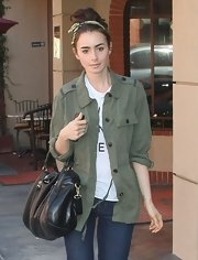 Lily Collins took a stroll in Beverly Hills carrying a stylish black Zadig & Voltaire leather tote.