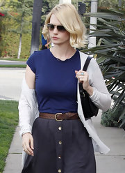January Jones teamed a brown leather belt with a gray button-front skirt for a day out in LA.