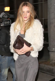 Rosie Huntington-Whiteley paired a buckled brown clutch with a white fur jacket for a night out in Beverly Hills.