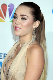 Miley Cyrus attended the 2011 American Giving Awards wearing a stunning pair of diamond chandelier earrings.