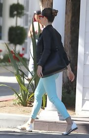 Jessica Biel was spotted out and about looking comfy in flat sandals by Givenchy.