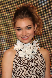 Imogen Poots went for statement styling with a chunky flower necklace.