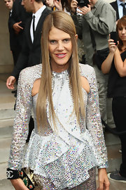 Anna dello Russo complemented her sequined dress with a diamond double-C cuff for total sparkle at the Giorgio Armani Prive fashion show.