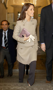 Princess Marie styled her look with a chic lilac leather clutch.