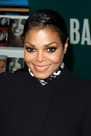 Janet Jackson sported a slick short 'do during her book signing.