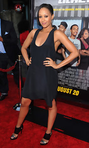 Tia Mowry teamed her black tank dress with black satin sandals with silver toe straps.