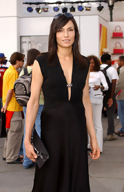 Famke Janssen carried a sleek black purse at Olympus Fashion Week.