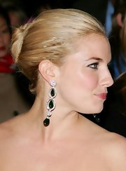 Sienna Miller accessorized with a stunning pair of gemstone and diamond drop earrings.