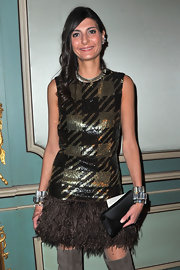 Giovanna Battaglia accessorized with layers of chunky cuff bracelets by CA&LOU for added shine to her sparkly dress.