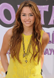 Miley Cyrus jazzed up her look with a layered rosary necklace by Virgins Saints & Angels.