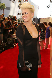 Miley Cyrus paired a black and silver box clutch by Edie Parker with a partially sheer gown for the 2012 MTV VMAs.