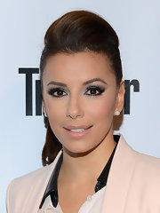 Eva Longoria accentuated her eyes with lots of gray shadow.
