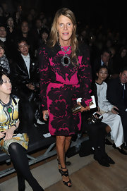 Anna dello Russo amped up the elegance with an oversized pendant necklace.