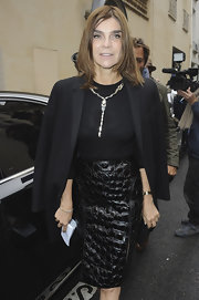 Carine Roitfeld added sparkle to her all-black outfit with a sophisticated silver Y-drop necklace when she attended the Balmain fashion show.