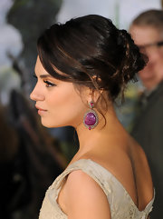 Mila Kunis went for edgy glamour with this mildly messy braided bun at the premiere of 'Oz the Great and Powerful.'