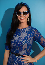 Katy Perry styled her dress with a skinny leather belt.