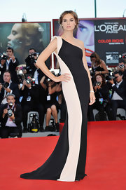Kasia Smutniak cut a sleek and elegant figure on the Venice Film Festival red carpet in a black-and-white one-shoulder gown by Armani Prive.