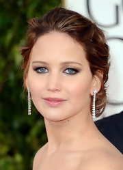 Jennifer Lawrence was all glammed up with a beautiful chignon and stunning diamonds at the Golden Globes.