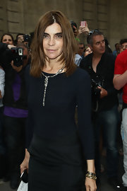 Carine Roitfeld styled her all-black outfit with some gold bracelets when she attended the Valentino fashion show.