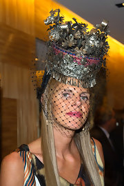 Anna dello Russo was elaborately styled with this intricate metal and mesh hat during the Louis Vuitton boutique opening in Paris.