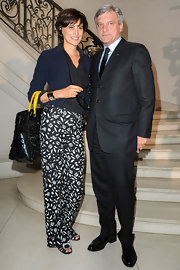 Ines de la Fressange wore unique print pants at the Christian Dior show.