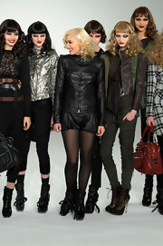 Gwen Stefani worked the L.A.M.B. runway wearing a black leather short suit.