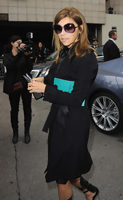 Carine Roitfeld arrived for the Hermes fashion show wearing a pair of retro-chic oversized purple sunglasses.