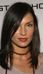 Famke Janssen plumped her lips with red lip color at the Conde Nast Traveler Hot List Party.