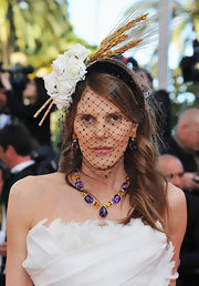 Anna dello Russo was all glammed up with a stunning gemstone necklace and matching earrings during the 'Tree of Life' premiere in Cannes.