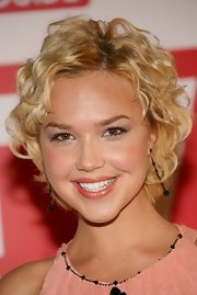 Arielle Kebbel wore her hair in a short curly style at the TV Guide Emmy party.