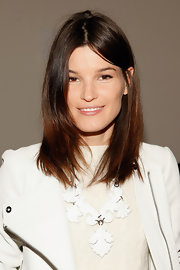 Hanneli Mustaparta sported a casual center-parted layered hairstyle at the Jeremy Laing fashion show.