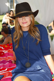 Stana Katic style her casual dress with an oversized pendant necklace when she attended the Fiji Water desert pool party.