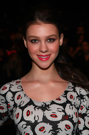 Nicola Peltz looked perky at the Betsey Johnson fashion show wearing bright pink lipstick and a Marilyn Monroe-print dress.