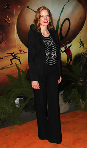 Jessica Chastain attended the opening of 'Ovo' looking sharp in a black Armani pantsuit teamed with a sequined top.