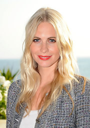Poppy Delevingne topped off her look with a bright red lip.