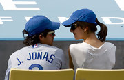 Camilla Belle matched her boyfriend's style with this Los Angeles Dodgers cap while watching a game.