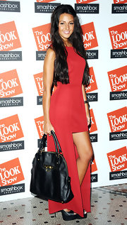 Michelle Keegan paired her frock with an oversized black leather tote.